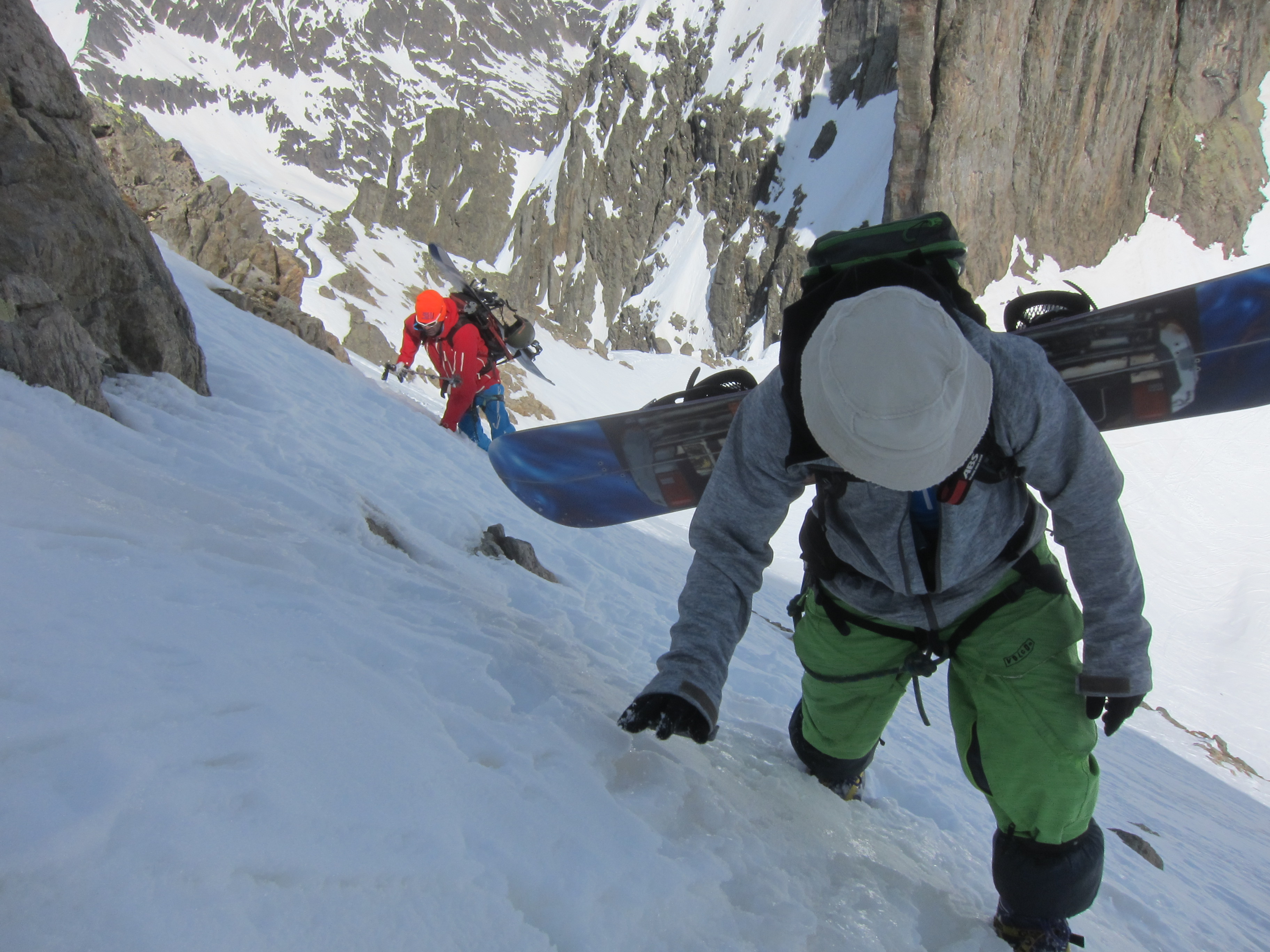 Steep boot packing to access the north couloir