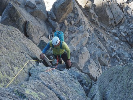 Pat pulling over in to the less steep groove after the crux 5b corner